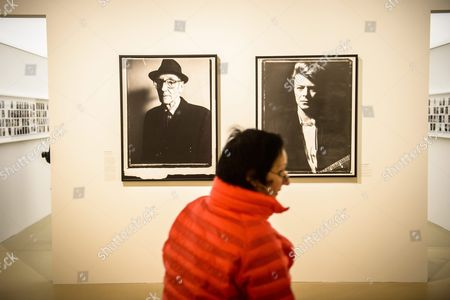 A Visitor Watches Polaroid Photographs of Us Writer William S Burroughs (l) and English Singer David Bowie (r) by Us Director Gus Van Sant During the Inauguration of His Retrospective Exhibition at the Paris Cinematheque in Paris France 11 April 2016 the Exhibition Runs From 13 April to 31 July 2016 France Paris