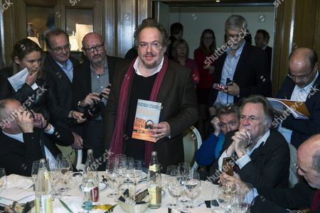 Goncourt Literary Price 2015 Laureate French Writer Mathias Enard (c) Poses with a Copy of His Book As He Just Received His Price For His Novel 'Boussole' at the Restaurant Drouant in Paris France 03 November 2015 France Paris