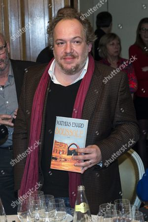 Goncourt Literary Price 2015 Laureate French Writer Mathias Enard Poses with a Copy of His Book As He Just Received His Price For His Novel 'Boussole' at the Restaurant Drouant in Paris France 03 November 2015 France Paris