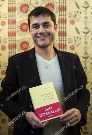 Stock Picture of French Writer Laurent Binet Poses at the Restaurant Lasserre After Winning the Interallie Literary Prize For His Novel 'La Septieme Fonction Du Language' (the Seventh Function of Language) in Paris France 12 November 2015 the Award is Purely Honorific and Has Been Awarded Annually by a Panel of Journalists Since 1930 France Paris
