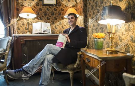 French Writer Laurent Binet Poses at the Restaurant Lasserre After Winning the Interallie Literary Prize For His Novel 'La Septieme Fonction Du Language' (the Seventh Function of Language) in Paris France 12 November 2015 the Award is Purely Honorific and Has Been Awarded Annually by a Panel of Journalists Since 1930 France Paris
