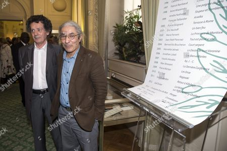 The Laureates of the French Academy Literary Prize 2015 Algerian Author Boualem Sansal (r) For His Novel '2084' and Tunisian Author Hedi Kaddour For His Novel 'Les Preponderants' Pose Next to the List of All the Winners at the French Academy in Paris France 29 October 2015 the French Academy Literary Prize Celebrates Its 100 Years of Existence France Paris