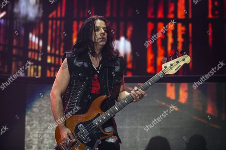 Polish Bass Guitarist Pawel Maciwoda of the Band Scorpions Performs During Their Concert in Paris France 24 November 2015 France Paris