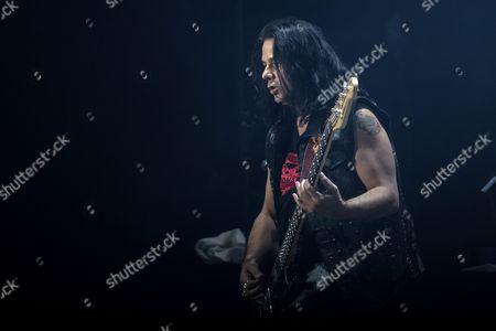 Polish Bass Guitarist Pawel Maciwoda of the Band Scorpions Performs During Their Concert in Paris France 24 November 2015 France Paris