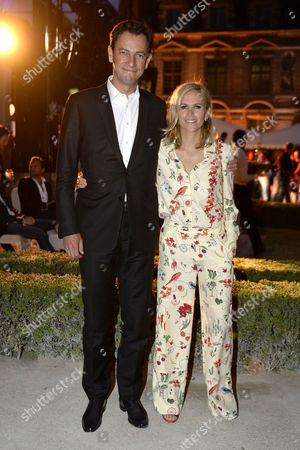 Us Designer Tory Burch (r) and Partner Ceo of the Lvmh Fashion Group Pierre-yves Roussel (l) Arrive For the Launch Party of the Tory Burch Company's Paris Flagship Store During the Haute Couture Fashion Week in Paris France 07 July 2015 the Presentation of the Fall/winter 2015/2016 Haute Couture Collections Runs From 05 to 09 July France Paris