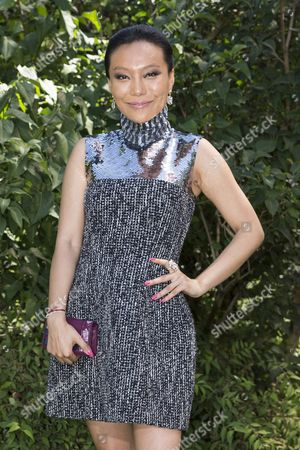 Stock Picture of Chinese Jewellery Designer and Artist Bao Bao Wan Poses For Photographs As She Arrives For the Presentation of the Dior Fall/winter 2015/2016 Haute Couture Collection During the Paris Fashion Week in Paris France 06 July 2015 the Presentation of the Haute Couture Collections Runs From 05 to 09 July France Paris