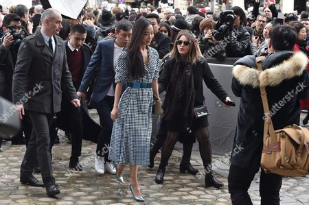 Stock Photo of Chinese Actress Wang Luodan (c) Arrives For the Presentation of the Fall/winter 2016/17 Ready to Wear Collection of Dior Fashion House During the Paris Fashion Week in Paris France 04 March 2016 This Dior Show is the First Ready-to-wear Show Since Former Creative Director Raf Simons Quit in October 2015 the Presentation of the Women's Collections Runs From 01 March to 09 March France Paris