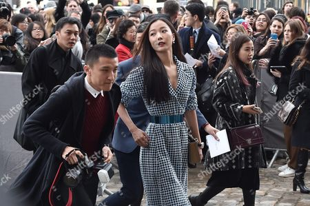 Stock Image of Chinese Actress Wang Luodan (c) Arrives For the Presentation of the Fall/winter 2016/17 Ready to Wear Collection of Dior Fashion House During the Paris Fashion Week in Paris France 04 March 2016 This Dior Show is the First Ready-to-wear Show Since Former Creative Director Raf Simons Quit in October 2015 the Presentation of the Women's Collections Runs From 01 March to 09 March France Paris