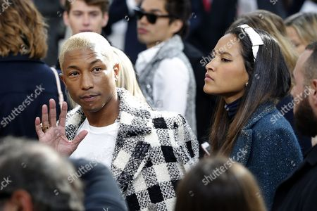 Us Singer Pharrell Williams (l) and Wife Helen Lasichanh (r) Attend the Presentation of the Fall/winter 2016/17 Ready to Wear Collection by German Designer Karl Lagerfeld For Chanel During the Paris Fashion Week in Paris France 08 March 2016 the Presentation of the Women's Collections Runs From 01 March to 09 March France Paris