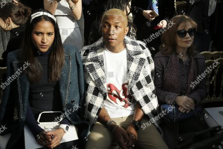 Us Singer Pharrell Williams (c) Wife Helen Lasichanh (l) and French Actress Isabelle Huppert (r) Attend the Presentation of the Fall/winter 2016/17 Ready to Wear Collection by German Designer Karl Lagerfeld For Chanel During the Paris Fashion Week in Paris France 08 March 2016 the Presentation of the Women's Collections Runs From 01 March to 09 March France Paris