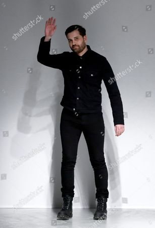 Us Designer Adam Andrascik Waves on the Catwalk After the Presentation of the Fall/winter 2016/17 Ready to Wear Collection For Guy Laroche During the Paris Fashion Week in Paris France 02 March 2016 the Presentation of the Women's Collections Runs From 01 March to 09 March France Paris