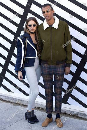 Belgian Singer Paul Van Haver Better Known As Stromae (r) and Wife Coralie Barbier (l) Arrive For the Presentation of the Spring/summer 2016 Ready to Wear Collection by French Designer Nicolas Ghesquiere For Louis Vuitton During the Paris Fashion Week in Paris France 05 October 2016 the Presentation of the Women's Collections Runs From 27 September to 05 October France Paris