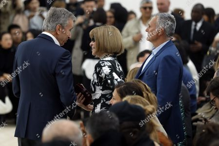 Lvmh Ceo Bernard Arnault (l) Discusses with Editor-in-chief of Us Vogue Anna Wintour (c) As He Arrives For the Spring/summer 2016 Ready to Wear Collection by British Designer Phoebe Philo For Celine During the Paris Fashion Week in Paris France 02 October 2016 the Presentation of the Womens Collections Runs From 27 September to 05 October France Paris
