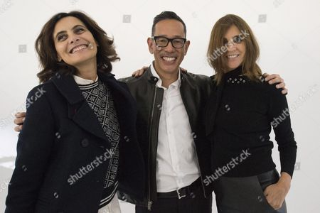 French Fashion Editor and Stylist Carine Roitfeld (r) Poses For Photographs with French Former Model Ines De La Fressange (l) and Uniqlo's Design Director Naoki Takizawa (c) As She Presents Her Capsule Collection For Uniqlo During the Spring/summer 2016 Ready to Wear Paris Fashion Week in Paris France 30 September 2015 the Presentation of the Women's Collections Runs From 29 September to 07 October France Paris