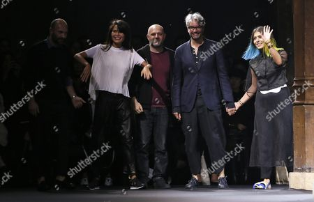 Stock Photo of Kazakhstan-born Vionnet Chairwoman and Creative Director Goga Ashkenazi (2-l) and British-turkish Designer Hussein Chalayan (c) Appear on the Catwalk with Italian Designers Albino D'amato (l) and Diego Dolcini (2-r) After the Presentation of Their Spring/summer 2016 Ready to Wear Collection For Vionnet Fashion House During the Paris Fashion Week in Paris France 30 September 2015 the Presentation of the Women?s Collections Runs From 29 September to 07 October France Paris