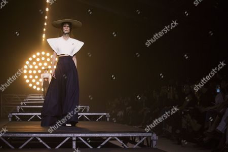 A Model Presents a Creation From the Spring/summer 2016 Ready to Wear Collection by French Designer Simon Porte Jacquemus During the Paris Fashion Week in Paris France 27 September 2016 the Presentation of the Women's Collections Runs From 27 September to 05 October France Paris