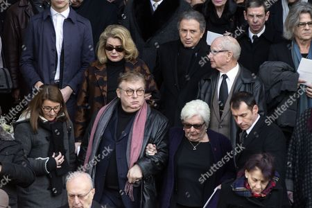 Stock Picture of French Tv Host Michel Drucker (back C) French Actress Catherine Deneuve (back L) French Producer Dominique Besnehard (front C-l) and French Singer Line Renaud (front C-r) Leave the Saint Sulpice Church After a Funeral Ceremony For French Singer Michel Delpech Prior to His Burial in Paris France 08 January 2016 Delpech Died Aged 69 on 02 January 2016 After Suffering From Cancer France Paris