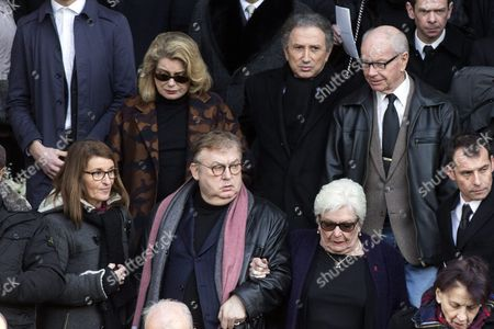 French Tv Host Michel Drucker (back C) French Actress Catherine Deneuve (back L) French Producer Dominique Besnehard (front C-l) and French Singer Line Renaud (front C-r) Leave the Saint Sulpice Church After a Funeral Ceremony For French Singer Michel Delpech Prior to His Burial in Paris France 08 January 2016 Delpech Died Aged 69 on 02 January 2016 After Suffering From Cancer France Paris