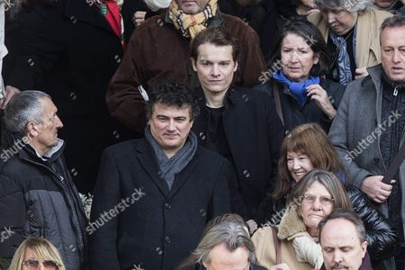 French Doctor Patrick Pelloux (l) and Singer Bruno Nicolini Alias Benabar (c) Leave the Saint Sulpice Church After a Funeral Ceremony For French Singer Michel Delpech Prior to His Burial in Paris France 08 January 2016 Delpech Died Aged 69 on 02 January 2016 After Suffering From Cancer France Paris