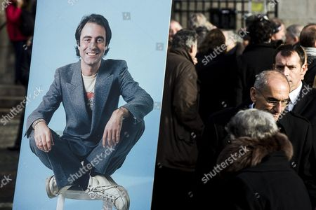 A Portrait of Late French Singer Michel Delpech is Displayed in Front of the Saint Sulpice Church where a Funeral Ceremony was Held Prior to His Burial in Paris France 08 January 2016 Delpech Died Aged 69 on 02 January 2016 After Suffering From Cancer France Paris