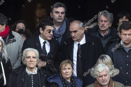 French Singer Marc Lavoine (c-l) and President of Universal Music France Pascal Negre (r) Leave the Saint Sulpice Church After a Funeral Ceremony For French Singer Michel Delpech Prior to His Burial in Paris France 08 January 2016 Delpech Died Aged 69 on 02 January 2016 After Suffering From Cancer France Paris