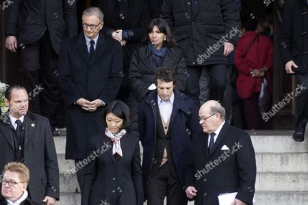 Paris Mayor Anne Hidalgo (c) Leaves the Saint Sulpice Church After a Funeral Ceremony For French Singer Michel Delpech Prior to His Burial in Paris France 08 January 2016 Delpech Died Aged 69 on 02 January 2016 After Suffering From Cancer France Paris