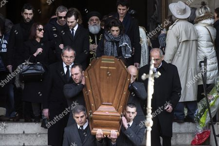 Stock Image of French Actress Pauline Delpech (c) Follows the Coffin of Her Late Father with Family and Friends As It is Carried out of the Saint Sulpice Church After a Funeral Ceremony For French Singer Michel Delpech Prior to His Burial in Paris France 08 January 2016 Delpech Died Aged 69 on 02 January 2016 After Suffering From Cancer France Paris
