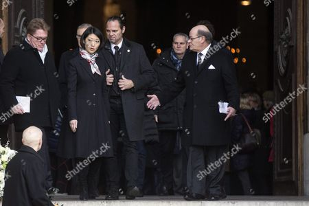 Stock Photo of French Minister of Culture and Communication Fleur Pellerin (2-l) Leaves the Saint Sulpice Church After a Funeral Ceremony For French Singer Michel Delpech Prior to His Burial in Paris France 08 January 2016 Delpech Died Aged 69 on 02 January 2016 After Suffering From Cancer France Paris
