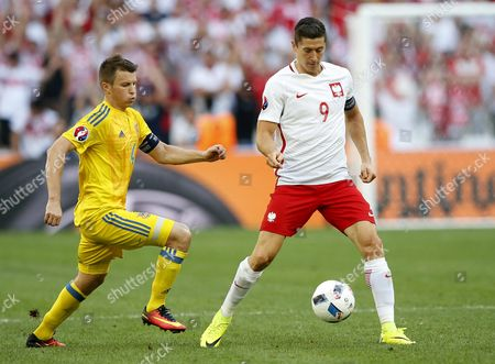 Stock Image of Anatoliy Tymoshchuk (l) of Ukraine and Robert Lewandowski of Poland in Action During the Uefa Euro 2016 Group C Preliminary Round Match Between Ukraine and Poland at Stade Velodrome in Marseille France 21 June 2016 (restrictions Apply: For Editorial News Reporting Purposes Only not Used For Commercial Or Marketing Purposes Without Prior Written Approval of Uefa Images Must Appear As Still Images and Must not Emulate Match Action Video Footage Photographs Published in Online Publications (whether Via the Internet Or Otherwise) Shall Have an Interval of at Least 20 Seconds Between the Posting ) France Marseille
