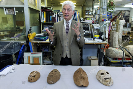 James Snyder Director of the Israel Museum with Four Limestone Masks From the Neolithic Period (ca 9 000 Years Ago) in the Basement of the Israel Museum in Jerusalem 05 March 2014 Before They Are Placed Into an Exhibition Called 'Face to Face ' the Masks Part of a Collection of Twelve Are the Oldest in the World and Were All Discovered in a Small Area in the Ancient Land of Israel From Outside Jerusalem to the Dead Sea Area They Have Been Researched For Nearly a Decade and Are Believed to Have Represented the Spirits of Dead Ancestors to Be Used in Religious and Social Ceremonies and in Rites of Healing Or Magic Two of the Ancient Masks Have Been in Israel and the Other Ten Were Brought Together For the Research and This Exhibition Israel Jerusalem