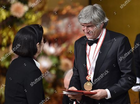 Italian Sculptor Giuseppe Penone (r) Receives His Prize During the Awards Ceremony of the 26th Praemium Imperiale in Tokyo Japan 15 October 2014 the Praemium Imperiale is a Global Arts Prize Awarded Annually by the Japan Art Association Five Laureates Are Nominated in the Fields of Painting Sculpture Architecture Music and Theatre/film For Its 26th Edition the Praemium Imperiale Awards Have Been Given to French Painter Martial Raysse Italian Sculptor Giuseppe Penone Us Architect Steven Holl South African Playwright Athol Fugard and Estonian-born Composer Arvo Part Japan Tokyo