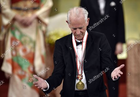 French Painter Martial Raysse Reacts After Receiving a Medal During the Awards Ceremony of the 26th Praemium Imperiale in Tokyo Japan 15 October 2014 the Praemium Imperiale is a Global Arts Prize Awarded Annually by the Japan Art Association Five Laureates Are Nominated in the Fields of Painting Sculpture Architecture Music and Theatre/film For Its 26th Edition the Praemium Imperiale Awards Have Been Given to French Painter Martial Raysse Italian Sculptor Giuseppe Penone Us Architect Steven Holl South African Playwright Athol Fugard and Estonian-born Composer Arvo Part Japan Tokyo