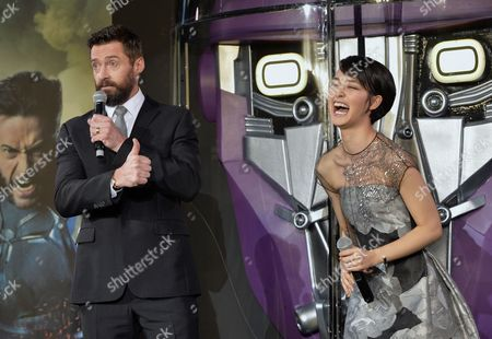 Australian Actor and Cast Member Hugh Jackman (l) Jokes with Japanese Actress and Model Ayame Goriki who is Dubbing in Japanese the Voice of the Movie's Mystique Character During the Premiere of 'X-men: Days of Future Past' in Tokyo Japan 27 May 2014 the Movie Will Be Released in Japanese Theatres on 30 May Japan Tokyo