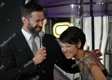 Australian Actor and Cast Member Hugh Jackman (l) Laughs with Japanese Actress and Model Ayame Goriki who is Dubbing in Japanese the Voice of the Movie's Mystique Character During the Premiere of 'X-men: Days of Future Past' in Tokyo Japan 27 May 2014 the Movie Will Be Released in Japanese Theatres on 30 May Japan Tokyo