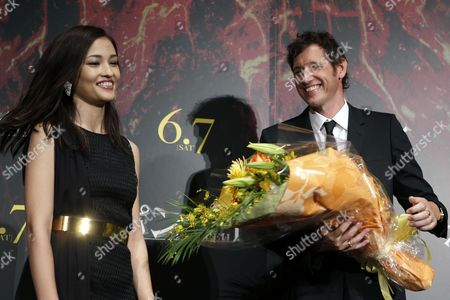 British Director Paul W S Anderson (r) Receives a Bouquet of Flowers From Japanese Actress Meisa Kuroki (l) on Stage During the Premiere of 'Pompeii' in Tokyo Japan 26 May 2014 the Movie Will Be Released in Japanese Theatres on 07 June Japan Tokyo