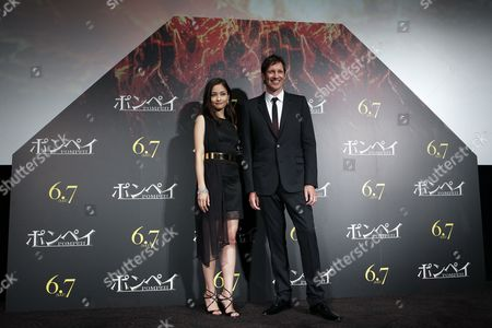 Stock Picture of British Director Paul W S Anderson (r) and Japanese Actress Meisa Kuroki Pose on Stage During the Premiere of 'Pompeii' in Tokyo Japan 26 May 2014 the Movie Will Be Released in Japanese Theatres on 07 June Japan Tokyo