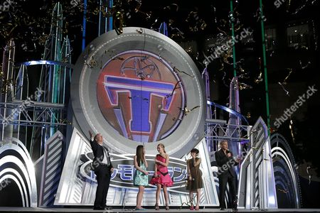 Stock Photo of (l-r) Us Film Director Brad Bird British Actress/cast Member Raffey Cassidy Us Actress/cast Member Britt Robertson Japanese Voiceover Actress For the Role of Casey Newton in the Movie Mirai Shida and Us Actor/cast Member George Clooney Pose on Stage During the Premiere of 'Tomorrowland' in Tokyo Japan 25 May 2015 the Science Fiction Adventure Movie Will Be Released in Theaters Across Japan on 06 June Japan Tokyo