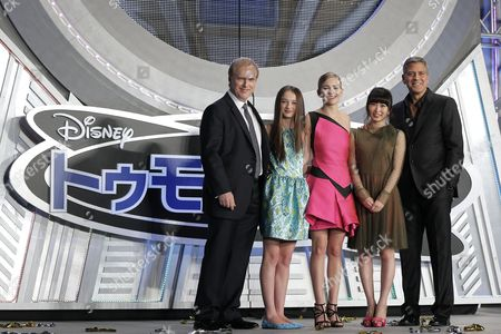 Stock Picture of (l-r) Us Film Director Brad Bird British Actress/cast Member Raffey Cassidy Us Actress/cast Member Britt Robertson Japanese Voiceover Actress For the Role of Casey Newton in the Movie Mirai Shida and Us Actor/cast Member George Clooney Pose on Stage During the Premiere of 'Tomorrowland' in Tokyo Japan 25 May 2015 the Science Fiction Adventure Movie Will Be Released in Theaters Across Japan on 06 June Japan Tokyo