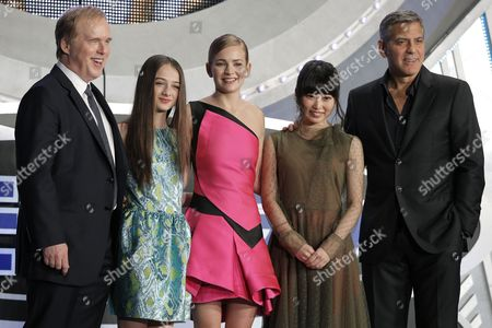 (l-r) Us Film Director Brad Bird British Actress/cast Member Raffey Cassidy Us Actress/cast Member Britt Robertson Japanese Voiceover Actress For the Role of Casey Newton in the Movie Mirai Shida and Us Actor/cast Member George Clooney Pose on Stage During the Premiere of 'Tomorrowland' in Tokyo Japan 25 May 2015 the Science Fiction Adventure Movie Will Be Released in Theaters Across Japan on 06 June Japan Tokyo