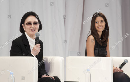 Izumi Mori (r) Model and Grand Daughter of Legendary Fashion Designer Hanae Mori (l) Smile During Their Talk Session Before the 'Et Momonakia' Brand Fashion Show During the Mercedes-benz Fashion Week in Tokyo Japan 18 October 2013 Tamaki Designed the Grandmother and Grand Daughter Fashion in Conjunction with the Japan 'Smile Project' to Promote Vitality Among Japan's Aging Populace and Closer Personal Relations Between the Young and Old Members of Society the Presentation of the Spring/summer 2014 Collections Runs From 14 to 19 October Japan Tokyo