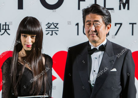 Japanese Actress Chiaki Kuriyama (l) and Japanese Prime Minister Shinzo Abe (r) Pose For Photographs During the Opening Green Carpet Event of the 26th Tokyo International Film Festival (tiff) in Tokyo Japan 17 October 2013 the Tiff Will Show a Variety of Movie Screenings Until 25 October Japan Tokyo