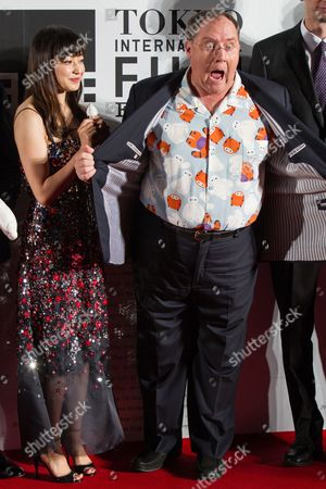Japanese Actress Miho Kanno (l) and Us Filmmaker John Lasseter (r) Attend the Opening Red Carpet Event of the 27th Tokyo International Film Festival (tiff) in Tokyo Japan 23 October 2014 the Tiff Will Show a Variety of Film Screenings Until 31 October Japan Tokyo