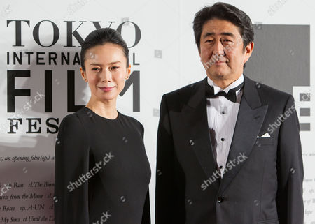 Japanese Actress Miki Nakatani (l) and Japanese Prime Minister Shinzo Abe (r) Attend the Opening Red Carpet Event of the 27th Tokyo International Film Festival (tiff) in Tokyo Japan 23 October 2014 the Tiff Will Show a Variety of Film Screenings Until 31 October Japan Tokyo