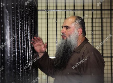 Radical Islamist Cleric Omar Mahmoud Othman Also Known As Abu Qatada Stands Behind Bars During His Trial at Jordan's State Security Court in Amman Jordan 07 September 2014 the Jordanian Judge Postponed the Announcement of a Verdict in Abu Qatada's Trial on Charges of Planning to Attack Tourists in Jordan at the Turn of the Century Known As the 'Millennium Bombings' Plot Until 24 September 2014 in Another Trial in July 2014 Abu Qatada was Acquitted of Conspiring to Commit Acts of Terrorism in the 1990s Jordan Amman