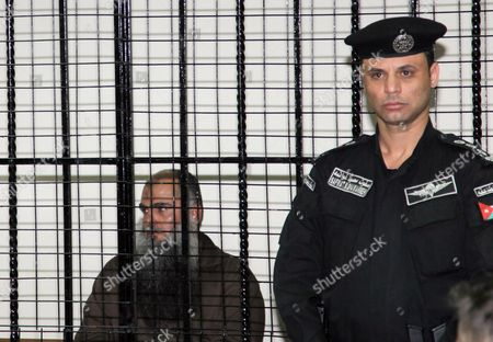 Radical Islamist Cleric Omar Mahmoud Othman (l) Also Known As Abu Qatada Sits Behind Bars at the Jordanian State Security Court in Amman Jordan 24 September 2014 the Jordanian Court on 24 September Acquitted Radical Cleric Abu Qatada of Terrorism-related Charges the Presiding Judge of the State Security Court Said in a Televized Session That There was Insufficient Evidence That Abu Qatada 53 was Involved in a 2000 Plan Against Tourists Known As the 'Millennium Bombings' Plot Jordan Amman