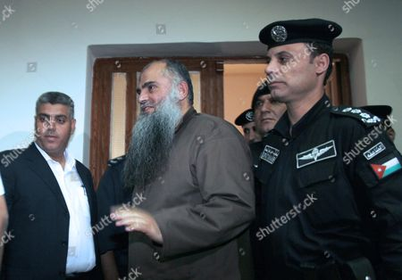 Radical Islamist Cleric Omar Mahmoud Othman (c) Also Known As Abu Qatada is Escorted Into the Jordanian State Security Court in Amman Jordan 24 September 2014 Others Are not Identified the Jordanian Court on 24 September Acquitted Radical Cleric Abu Qatada of Terrorism-related Charges the Presiding Judge of the State Security Court Said in a Televized Session That There was Insufficient Evidence That Abu Qatada 53 was Involved in a 2000 Plan Against Tourists Known As the 'Millennium Bombings' Plot Jordan Amman