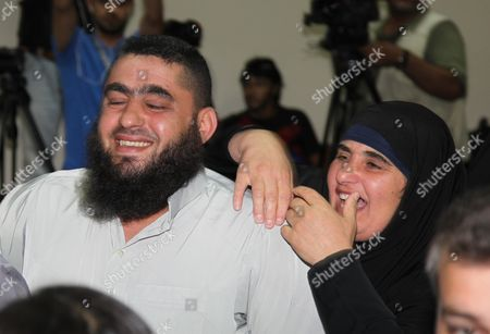 Stock Image of Relatives of Radical Islamist Cleric Omar Mahmoud Othman Also Known As Abu Qatada React After the Verdict at the Jordanian State Security Court in Amman Jordan 24 September 2014 the Jordanian Court on 24 September Acquitted Radical Cleric Abu Qatada of Terrorism-related Charges the Presiding Judge of the State Security Court Said in a Televized Session That There was Insufficient Evidence That Abu Qatada 53 was Involved in a 2000 Plan Against Tourists Known As the 'Millennium Bombings' Plot Jordan Amman