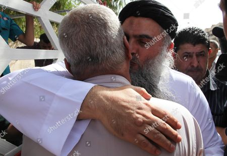 Radical Islamist Cleric Omar Mahmoud Othman (r) Also Known As Abu Qatada is Greeted by a Relative As He Arrives at His Home After a Court Acquitted Him of Terrorism-related Charges in Amman Jordan 24 September 2014 Jordanian Military's State Security Court on 24 September Acquitted Abu Qatada of Terrorism-related Charges Abu Qatada's Case Marks the Third Time a High-profile Radical Cleric Has Been Released by Jordanian Authorities Over the Past Three Months Jordan Amman