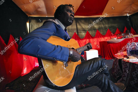 Senegalese Musician Baaba Maal Plays the Guitar Backstage Before Performing on Stage During the Koroga Festival at the Arboretum in Nairobi Kenya 15 June 2014 the Festival Seeks to Showcase Local Kenyan Talent While Attracting Leading Artists From Around the World Maal is a Renowned Senegalese Singer and Guitarist Born in Podor North of Senegal He is One of the Main Ambassadors of West African Music He is an United Nations Ambassador and Also Known For His Work in Promoting Peace Kenya Nairobi