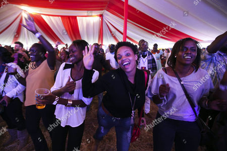 Kenyan Music Fans Dance During the Performance of Senegalese Musician Baaba Maal (unseen) at the Koroga Festival at the Arboretum in Nairobi Kenya 15 June 2014 the Festival Seeks to Showcase Local Kenyan Talent While Attracting Leading Artists From Around the World Maal is a Renowned Senegalese Singer and Guitarist Born in Podor North of Senegal He is One of the Main Ambassadors of West African Music He is an United Nations Ambassador and Also Known For His Work in Promoting Peace Kenya Nairobi